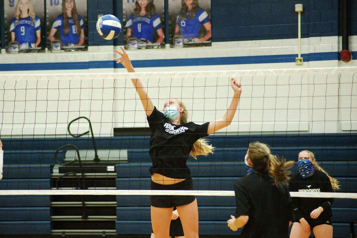 Sarah Sitton participates in a mock game drill during the Friendswood High varsity volleyball team's practice on Sept. 10.