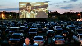 """The movie """"1408"""" plays at the Mission Drive-In in August 2007. The theater opened in March 1948 and is a South Side landmark."""
