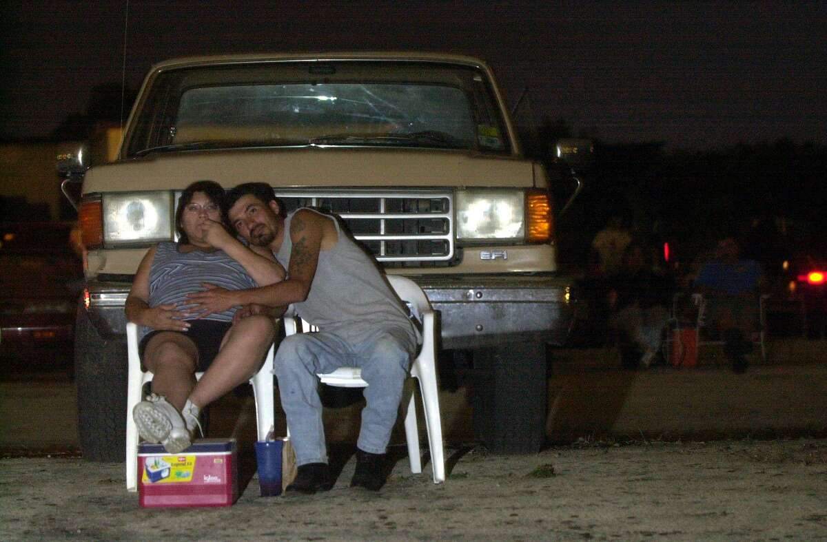 Jeannie Lozano, 28, and husband Rudy Lozano, 36, watch