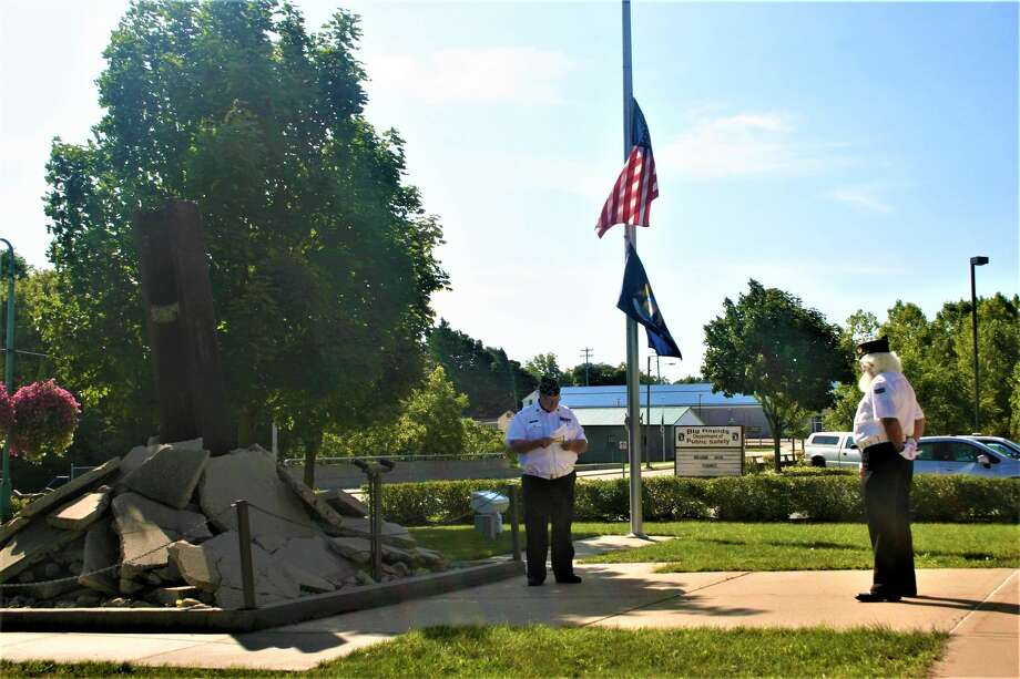 The Big Rapids American Legion Post 98 Honor Guard paid tribute to the victims of 9/11 at a ceremony, Friday, at the 9/11 memorial on the grounds of the Big Rapids Police Department and Fire station. Photo: Pioneer Photo/Cathie Crew