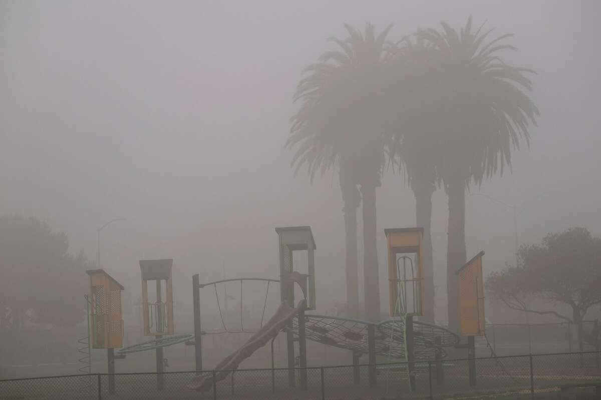 A playground sits empty in dense smoke and fog on Treasure Island, San Francisco on Friday, September 11, 2020. San Francisco continues to experience extremely poor air quality due to the wildfires.