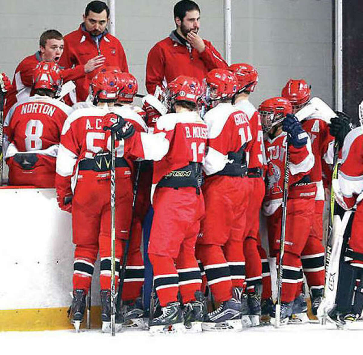 The Alton Redbirds hockey team receives between-periods instructions during a 2019 game. The high-school hockey league has elected to delay the start of the upcoming season from November to January because of the COVID-19 pandemic.