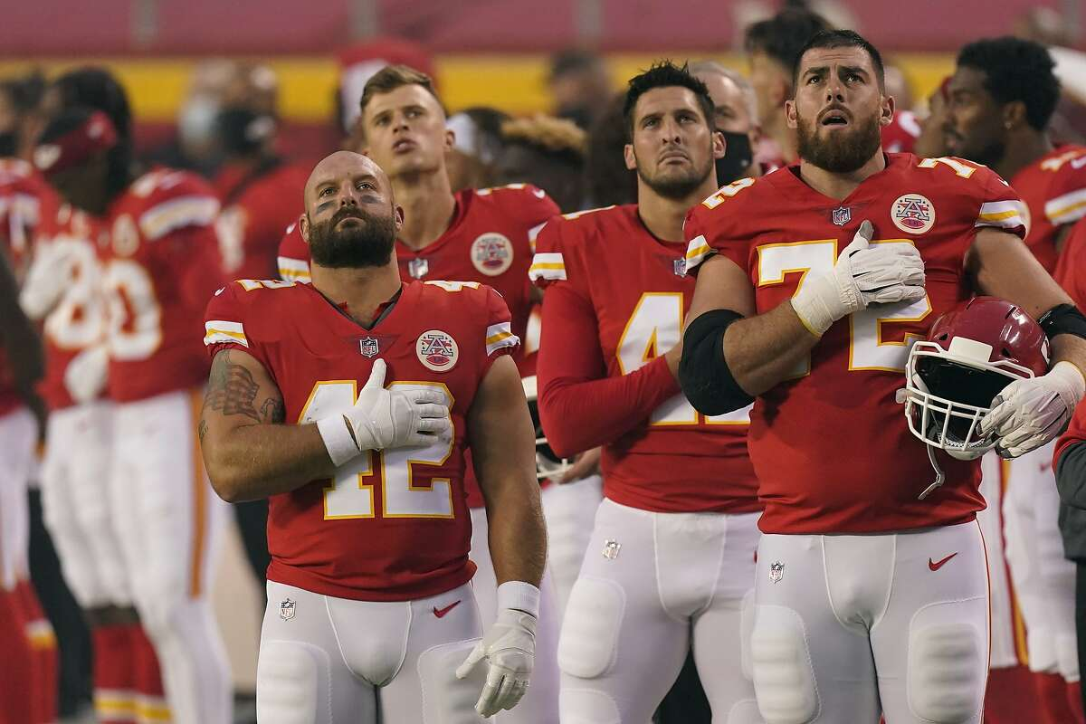 Kansas City Chiefs players stand for the national anthem before an NFL football game against the Houston Texans Thursday, Sept. 10, 2020, in Kansas City, Mo. (AP Photo/Charlie Riedel)