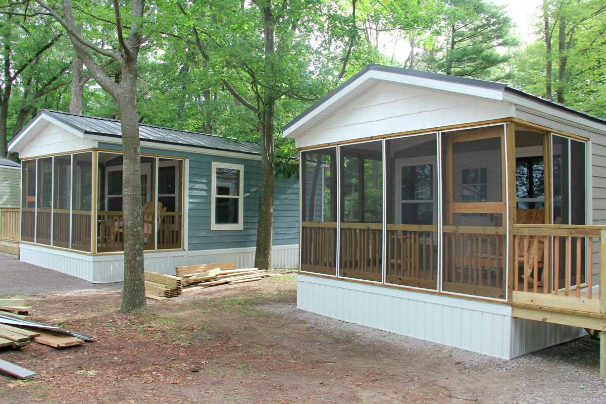 Two of the new cabins at Port Crescent State Park. Five new cabins are expected to be open to rent before the end of the month, with a full amenity cabin and two geodesic domes to be completed for the next camping season. (Robert Creenan/Huron Daily Tribune)
