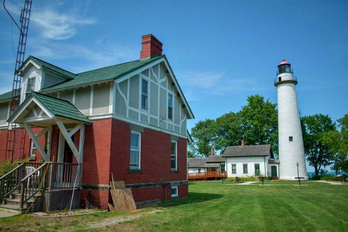 The Assistant Keepers house at the Pointe aux Barques Lighthouse going through renovation work. The Pointe aux Barques Lighthouse Society restored the place thanks to donations from Habitat for Humanity and financial help from Bay Port State Bank. (Tribune File Photo)