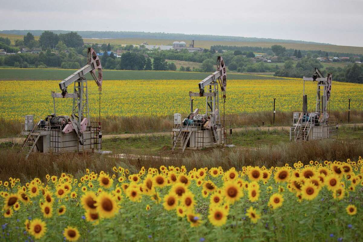 """Daniel Yergin explores the struggle by Russia to re-assert itself as an economic and political power following the collapse of the Soviet Union. Oil pumping jacks, also known as """"nodding donkeys,"""" operate in an oilfield near Almetyevsk, Russia in August, 2020."""