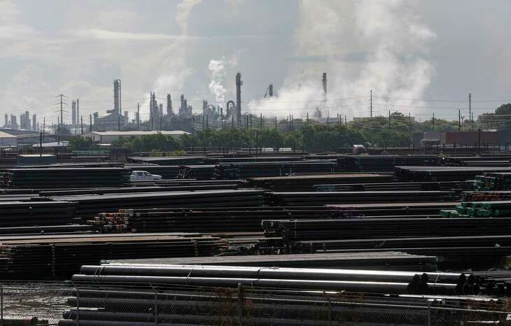 Pipes and a refinery complex, photographed Wednesday, July 22, 2020, in Houston.