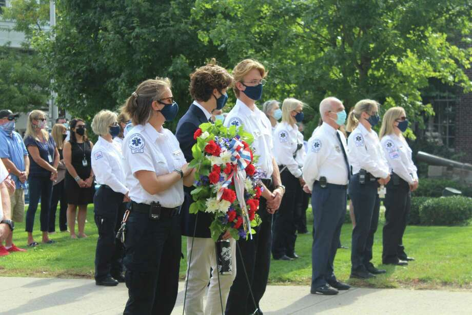 Members of New Canaan EMS stand front and center at New Canaan's 9-11 remembrance Friday at Town Hall. Photo: John Kovach / Hearst Connecticut Media / New Canaan Advertiser