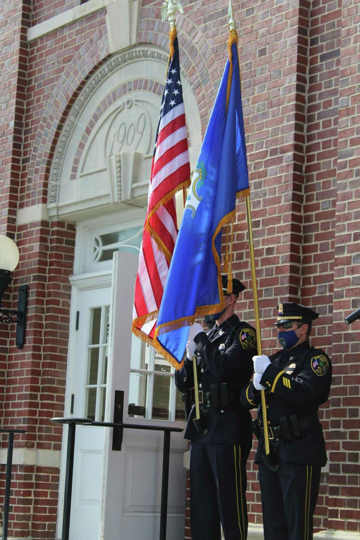 New Canaan Police present the colors on the steps of Town Hall Friday as New Canaan pauses to mark the 19th anniversary of the terrorist attacks of Sept. 11, 2001.