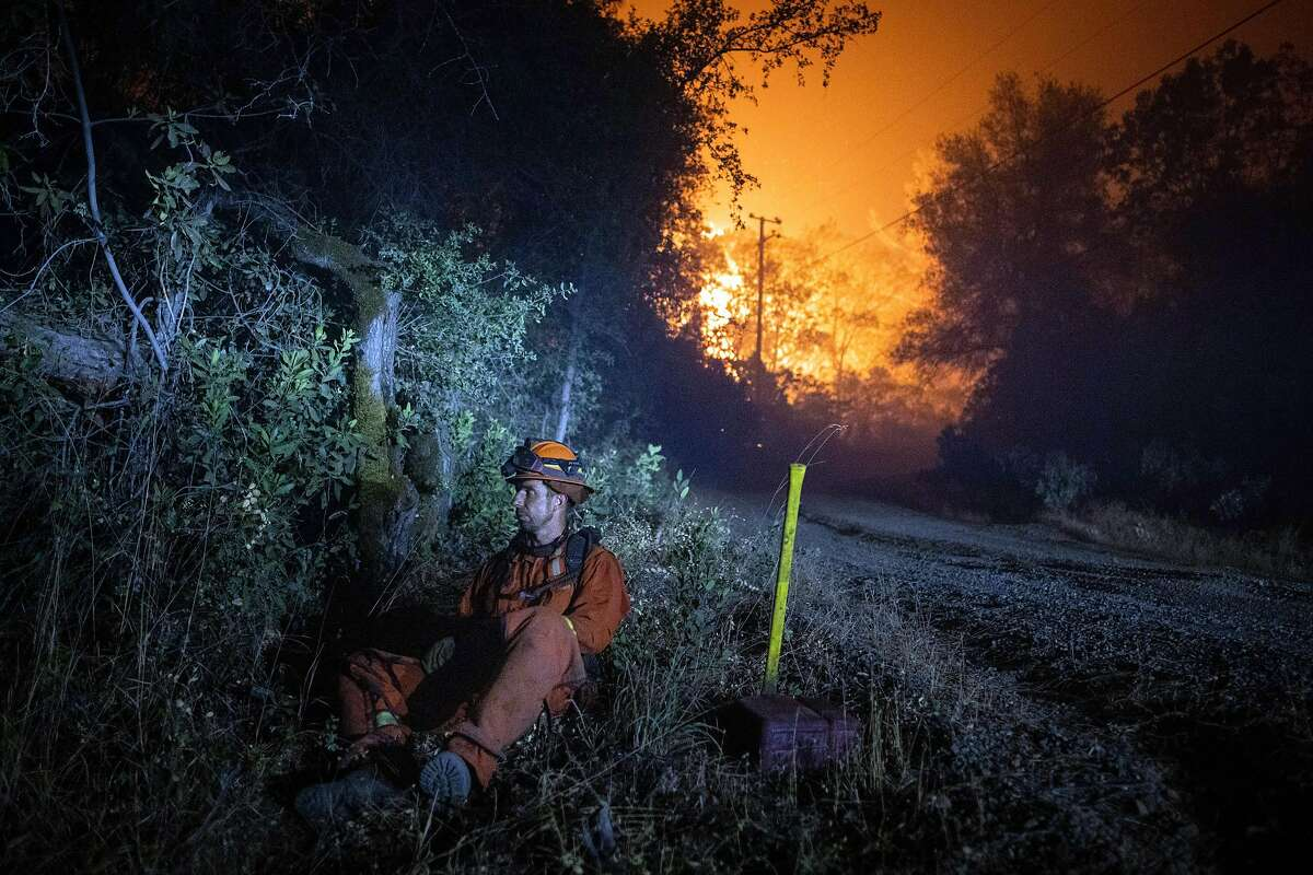 An inmate firefighter with Vallecito Crew 1 takes a break while battline the Bear Fire, part of the North Complex Fire, on Thursday, Sept.10, 2020 near Oroville, Calif. Wildfires in California, Oregon and Washington State have killed at least seven people, and there are growing fears more have died in towns that have been destroyed. (Christian Monterrosa/The New York Times)