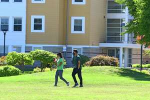 Students are seen walking among Empire Commons dormitory at University at Albany on Friday, Sept. 11, 2020 in Albany, N.Y. (Lori Van Buren/Times Union)