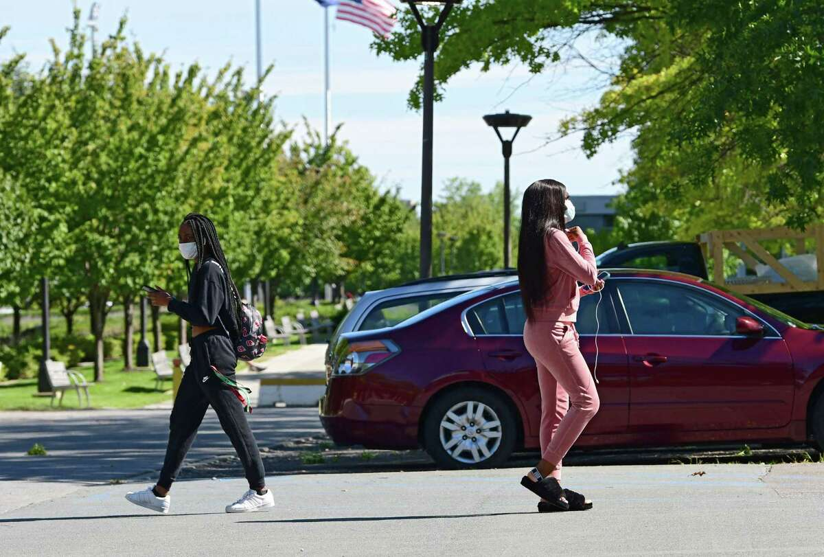 Students are seen walking to and from Colonial Quad dormitory at University at Albany on Friday, Sept. 11, 2020 in Albany, N.Y. (Lori Van Buren/Times Union)