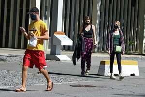 Students are seen walking from Colonial Quad dormitory at University at Albany on Friday, Sept. 11, 2020 in Albany, N.Y. (Lori Van Buren/Times Union)