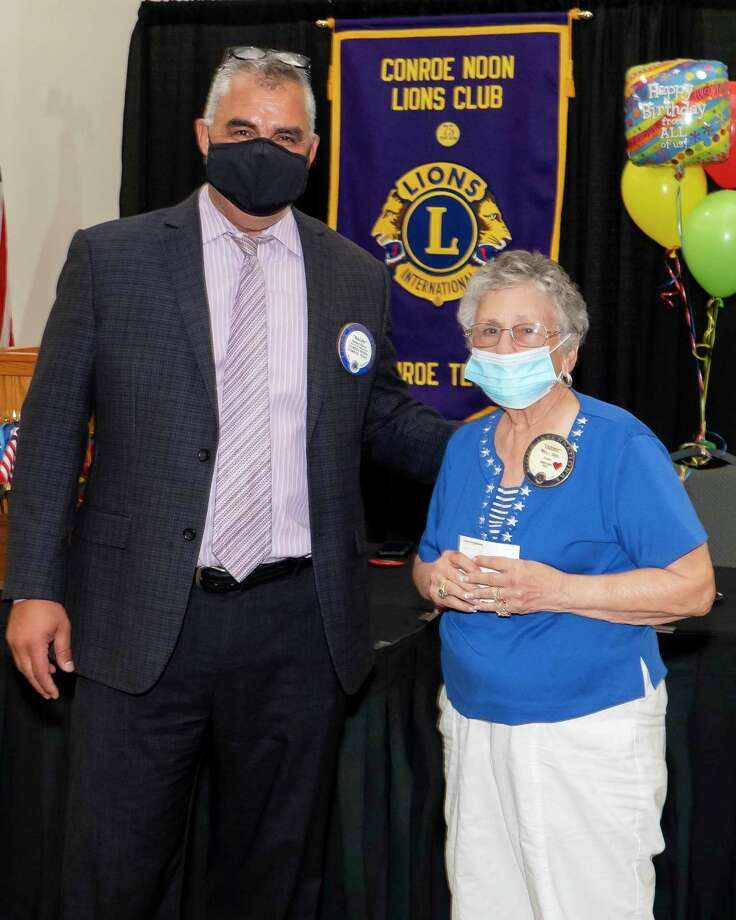 Last Wednesday Conroe Noon Lions Club President Ralph Perez, left, congratulates Lion Ladoris Cates on 25 years of perfect attendance. Photo: Courtesy Photo