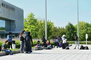Students wait at the bus stop in Collins Circle at University at Albany on Friday, Sept. 11, 2020 in Albany, N.Y. (Lori Van Buren/Times Union)
