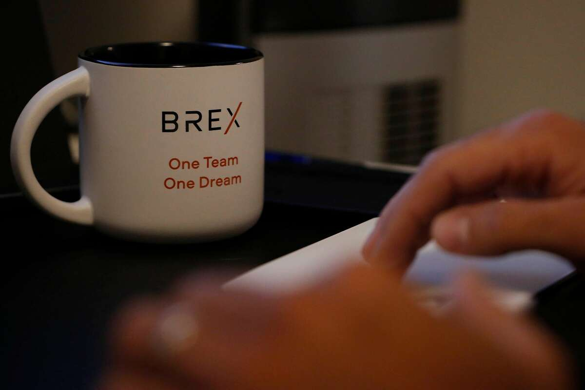 A mug with a BREX logo is seen on a mug next to a keyboard as Joel Baroody, BREX head of recruiting, works in his home office on Wednesday, September 9, 2020 in Mill Valley, Calif.