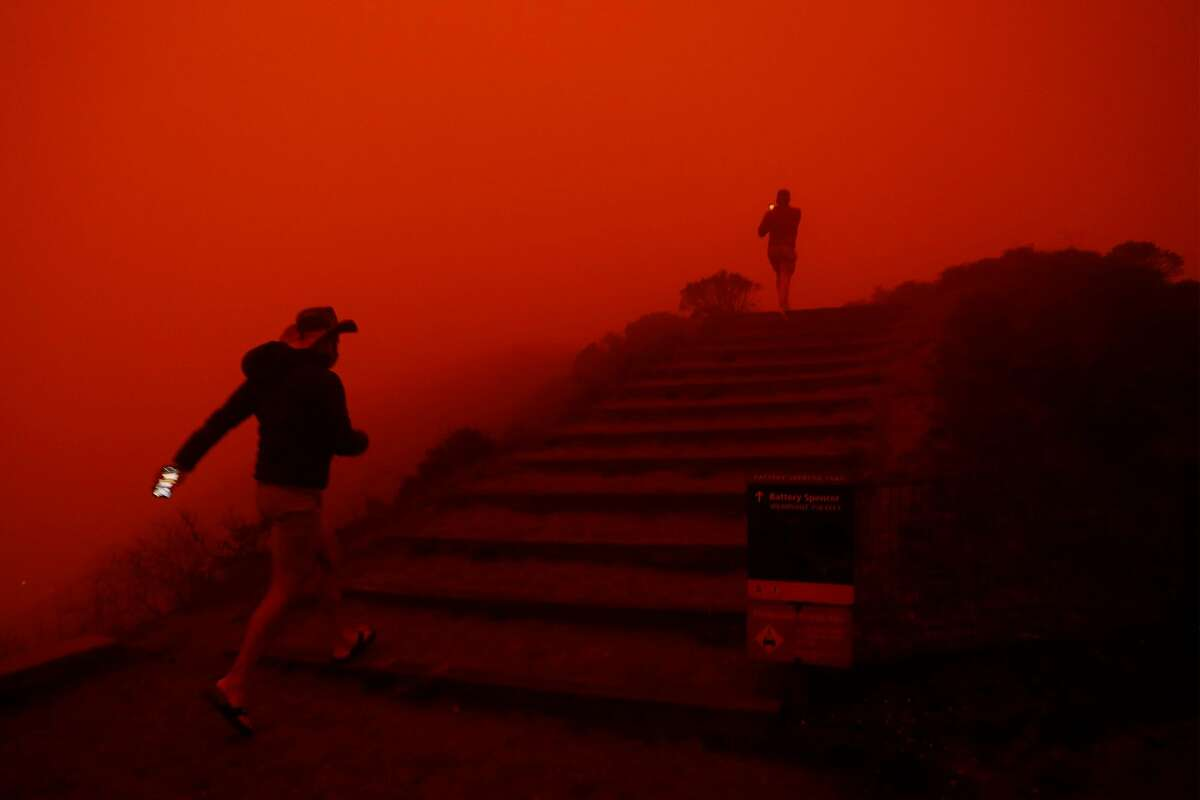 Shrouded by wildfire smoke filtered light, Thomas Spratley (right) and Paulo Santos of Sausalito visit the Marin Headlands in Sausalito, Calif., on Wednesday, September 9, 2020.