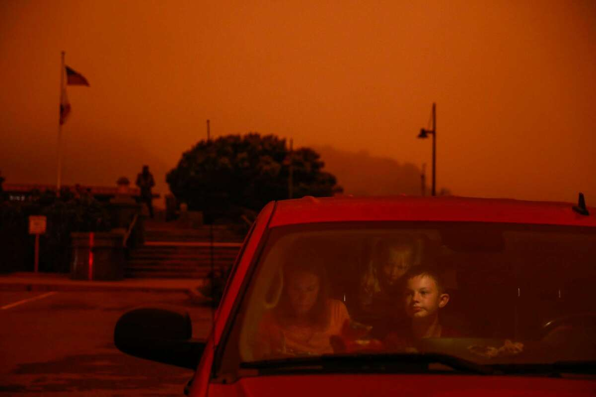 Lisa Trythall, of Salt Lake City, makes sandwiches for her children including son Luke Trythall (right) as they sit in their car during a road trip in Sausalito, Calif. Wednesday, September 9, 2020. The sky was orange and smoky due to multiple wildfires burning across California and Oregon.