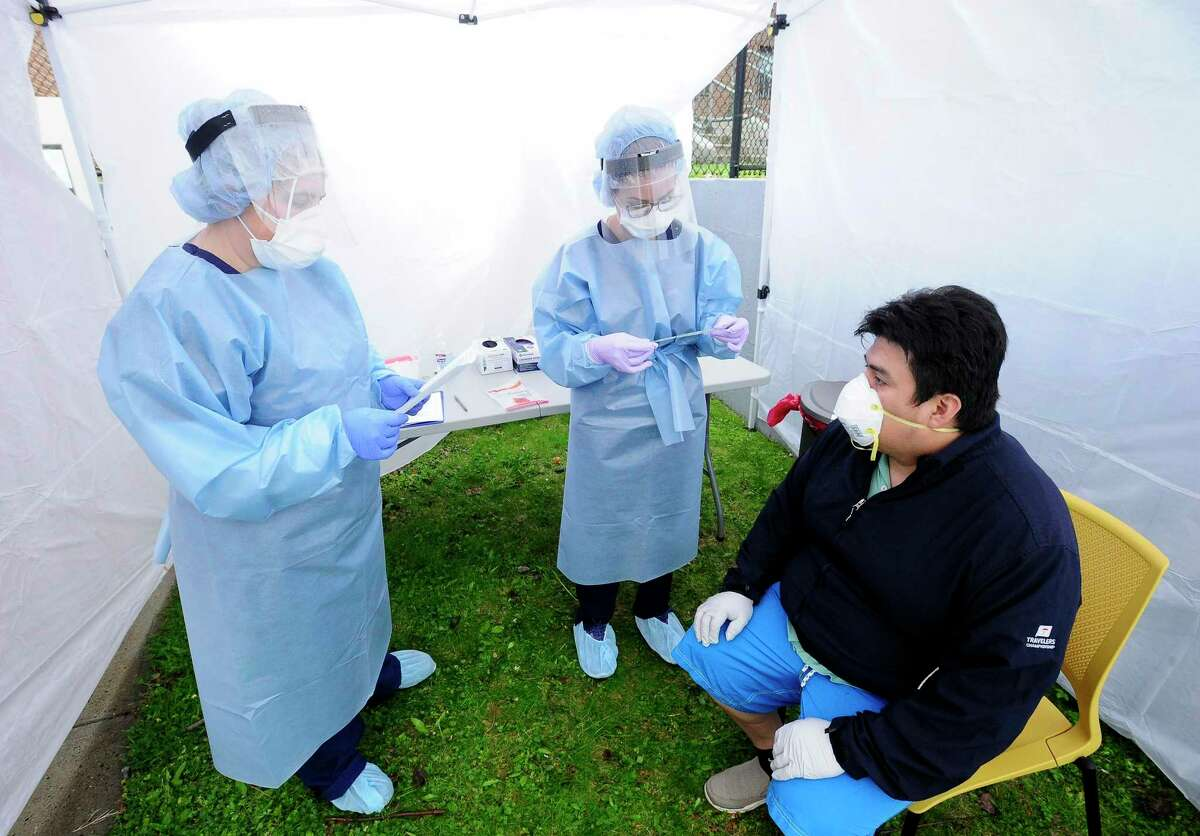 Nurse Practitioners prepare to test a Greenwich resident with an oral swab for the COVID-19 Coronavirus at a testing site in Greenwich, Connecticut on May 1, 2020. The good news is, that's starting. Researchers in the United Kingdom are looking at 10,000 patients for a full year. Here in the states, the CORAL project, run by the National Institutes for Health, is keeping up with 1,500 patients, following their outcomes from their first admission to the hospital through the recovery process, taking biological samples along the way. Terri Hough, who helped design the CORAL project, said a few months ago that it's a question of unknowns.
