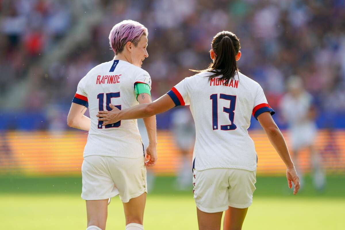 Megan Rapinoe (left) celebrates scoring with teammate Alex Morgan during a 2019 FIFA Women's World Cup France Round of 16 match between Spain and the United States at Stade Auguste-Delaune on June 24, 2019 in Reims, France.