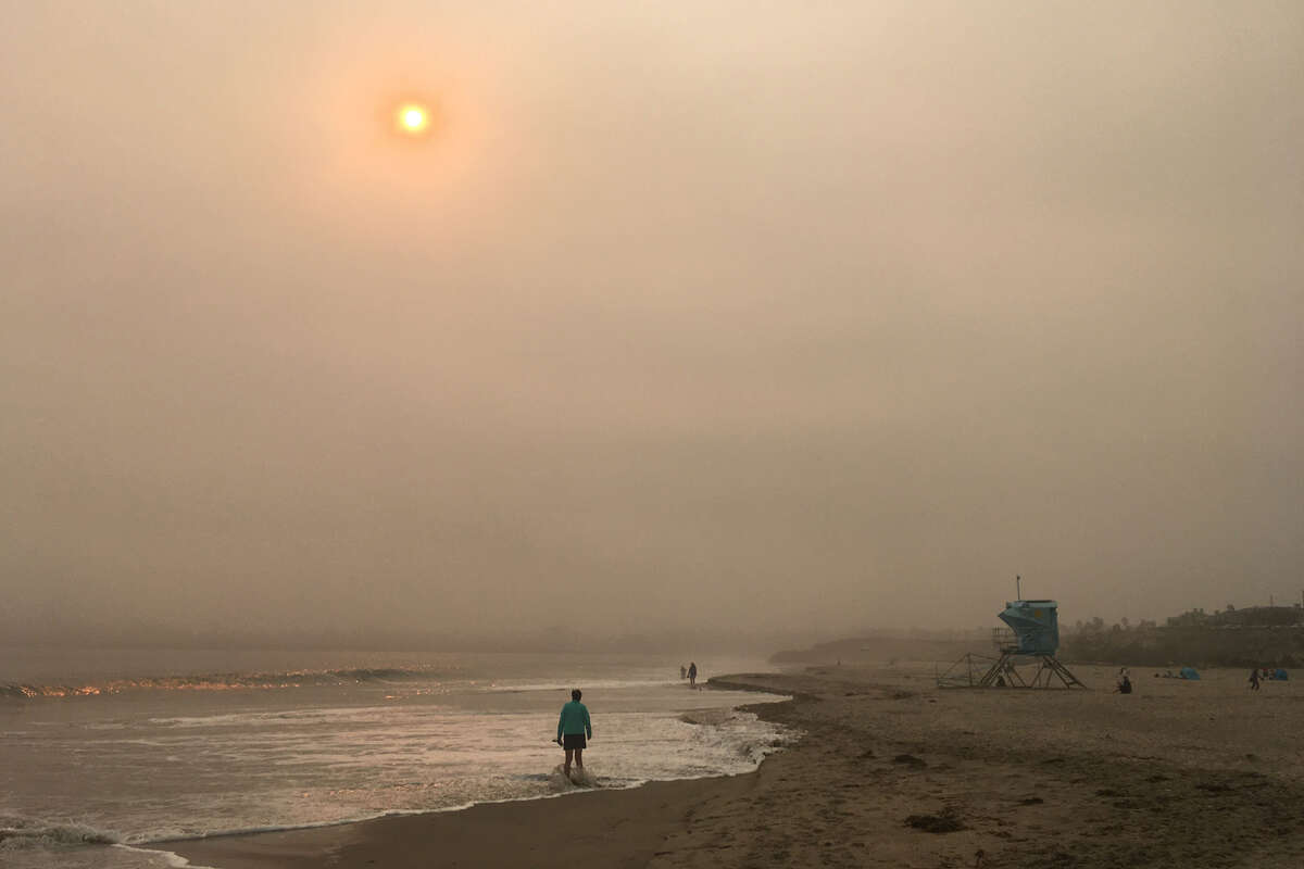 Smoke from wildfires obscures the sun in Santa Cruz, Calif.