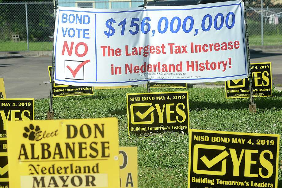 Election signs fill the grassy area across from City Hall in Nederland, which is the polling site for early voters. The majority are urging yes and no votes to the NISD bond proposal. Photo taken Thursday, April 25, 2019 Kim Brent/The Enterprise Photo: Kim Brent / The Enterprise / BEN