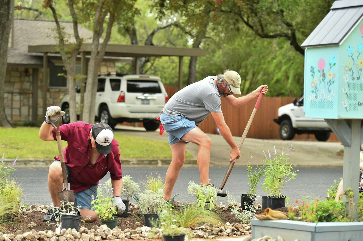 Len Conrad and Matthew Reeb work on landscaping a small park on Highcliff Drive. A reader is delighted to see neighbors coming together to better the community.
