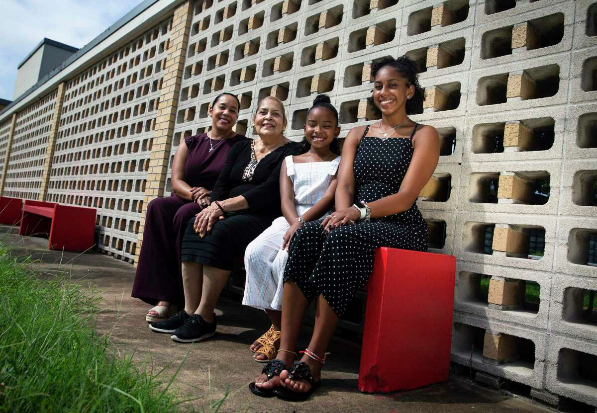 Burnell Loche, 66, poses for a photograph with her daughter, Edwina Loche Barrett, 42, and granddaughters, Eryn Levy, 16, and Parker Barrett, 9, Friday, Sept. 11, 2020, at Betsy Ross Elementary School in Houston. Loche was one of 12 Black students to first attend previously all-white campuses in 1960 when desegregation began in Houston ISD, enrolling in Betsy Ross Elementary School. The experience shaped Loche's views on education and integration, an ethos now passed down to the generations.