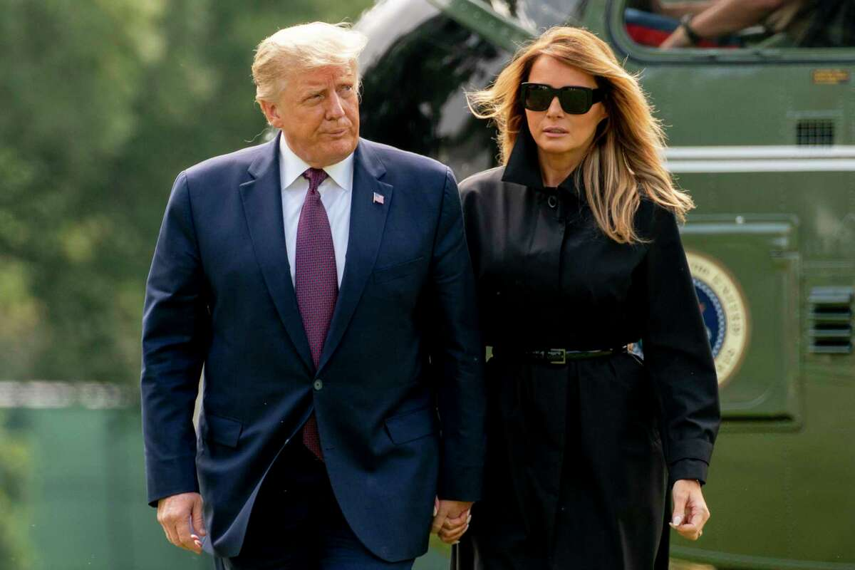 President Donald Trump and first lady Melania Trump arrive on the South Lawn of the White House in Washington Sept. 11, after returning from the Flight 93 National Memorial in Shanksville, Pa.