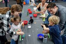 Children fill their sensory bottles with sparkles, beads and crystals which withal glow in the dark. The Beaumont Children's Museum hosted Glow Mania on Saturday, December 28, 2019 with a variety of glowing activities for children. Fran Ruchalski/The Enterprise