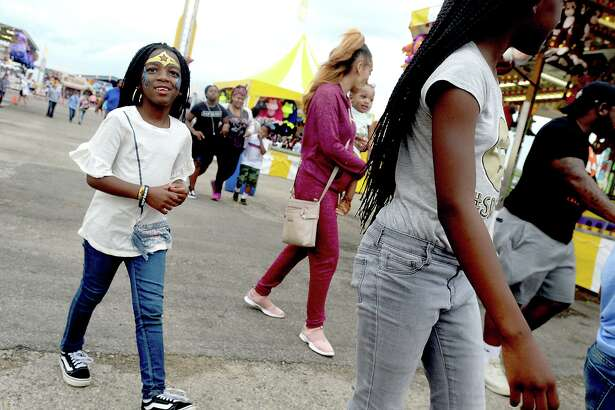 Carnival-goers enjoy the South Texas State Fair Saturday. Sunday marks the final day of this year's fair, with gates opening at noon and closing at 8 p.m. or later depending upon attendance. Photo taken Saturday, March 30, 2019 Kim Brent/The Enterprise