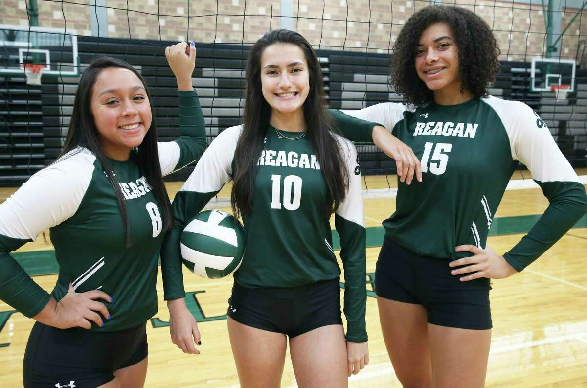 Reagan High School volleyball players Maddie Correa, Julia Aleman and Nyah Anderson on Sept. 10, 2020.