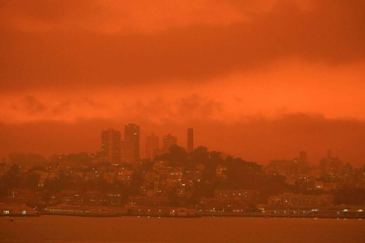 Heavy smoke form fires burning in the region brought a cloud of darkness to San Francisco skyline on Wednesday morning, Sept. 9, 2020, as seen from Treasure Island in San Francisco Bay. Wildfires were ripping through several Western states on Wednesday, destroying homes and forcing thousands of people to evacuate as an extraordinary number of blazes raged in California, Washington and Oregon.