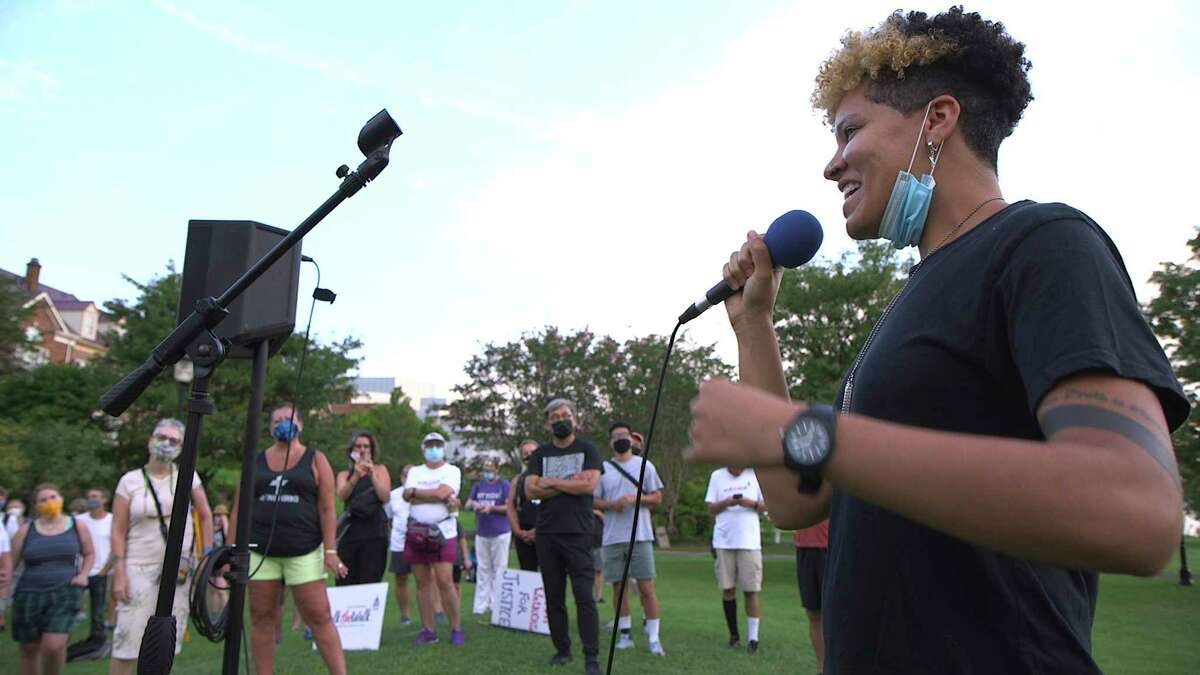 In this image taken from video, activist and rapper Genesis Be performs her poem