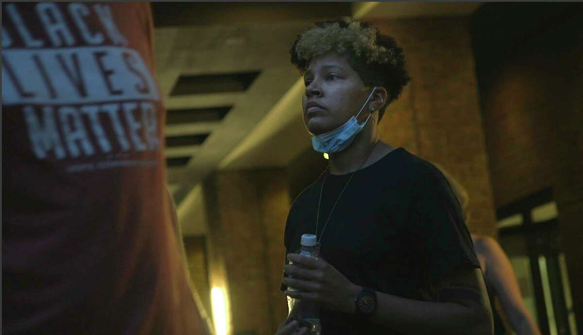 In this image taken from video, activist and rapper Genesis Be leaves her hotel on Thursday, Aug. 27, 2020, in Washington, before attending an event for Vote Common Good, a campaign aimed at Christian voters in swing states. Genesis Be helped ignite a nationwide conversation around the Confederate emblem as part of Mississippi's state flag until the flag was retired in June. (AP Photo/Federica Narancio)
