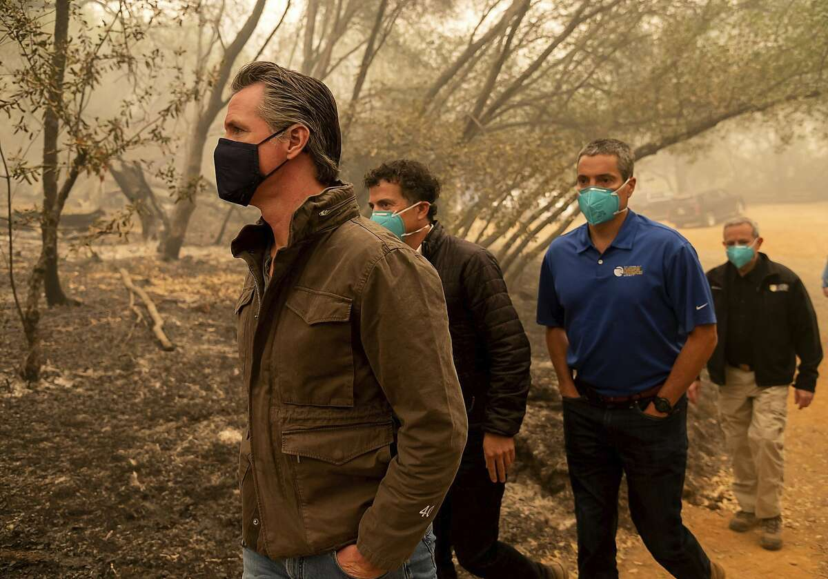 Gov. Gavin Newsom tours the North Complex Fire zone with state Environmental Protection Secretary Jared Blumenfeld, second from left, and Natural Resources Secretary Wade Crowfoot outside Oroville in Butte County on Sept. 11, 2020.