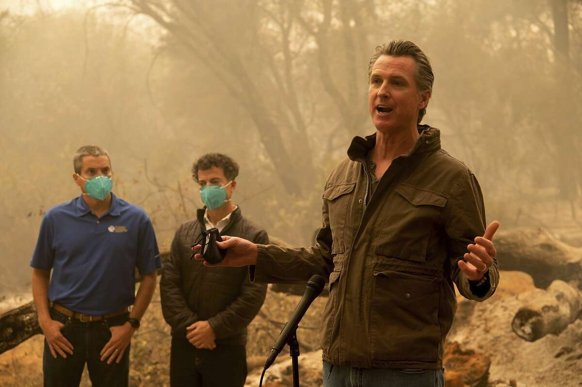 Gov. Gavin Newsom talk to the media after he toured the North Complex Fire zone with California Secretary for Natural Resources Wade Crowfoot, left, and California Secretary for Environmental Protection Jared Blumenfeld in Butte County on Friday, Sept. 11, 2020, outside of Oroville, Calif. (Paul Kitagaki Jr./The Sacramento Bee via AP, Pool)