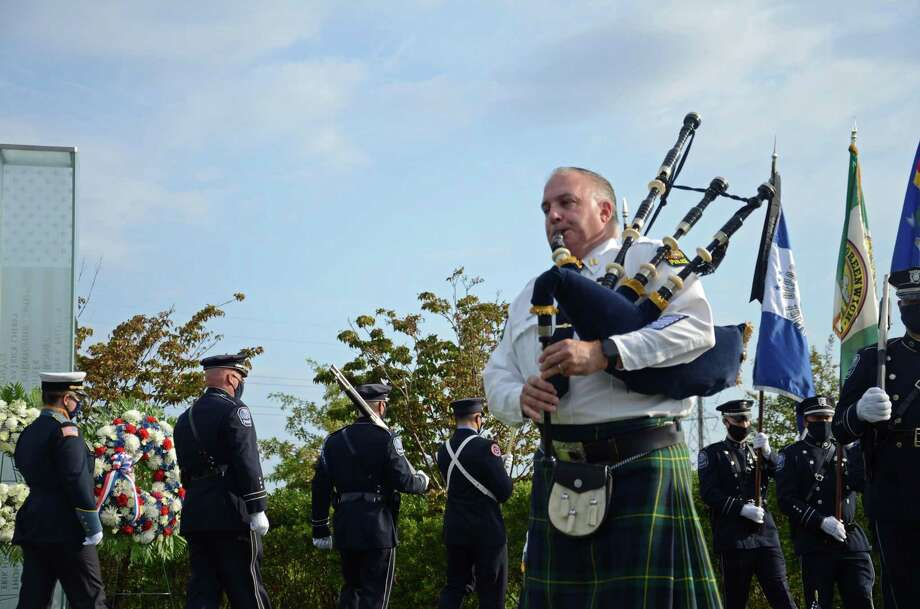 Captain Jim Bonney with Greenwich Police Department plays the bagpipe at the annual Sept. 11 memorial services in Cos Cob Park. Photo: Tatiana Flowers / Hearst Connecticut Media / Greenwich Time