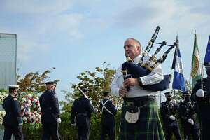 Captain Jim Bonney with Greenwich Police Department plays the bagpipe at the annual Sept. 11 memorial services in Cos Cob Park.