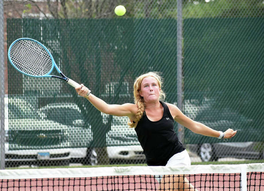 Edwardsville's Maddy Jones reaches for a shot at the net during her No. 3 doubles match against Alton on Friday inside the EHS Tennis Center. Photo: Matt Kamp|The Intelligencer