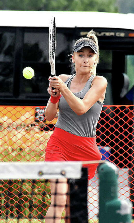 Alton's Ainsley Fortschneider hits a shot during her No. 1 doubles match against Edwardsville on Friday at the EHS Tennis Center. Photo: Matt Kamp | For The Telegraph