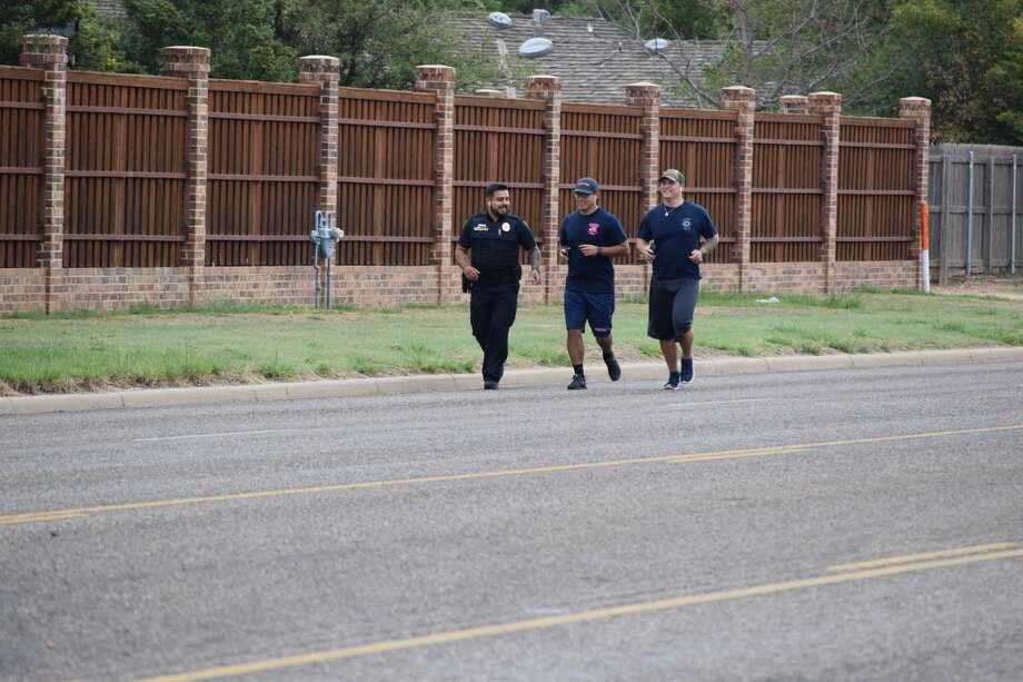 Cpl. Jesse Ortiz, with the Plainview Police Department, and Firefighters Bryan Alvarado and Jesse Edwards, with Plainview Fire/EMS, ran from Fire Station 2 at 911 Quincy St. to Fire Station 3 at 3405 southwest 3rd St. Friday morning in honor of those who died 19 years ago on Sept. 11, 2001. Photo: Ellysa Harris/Plainview Herald