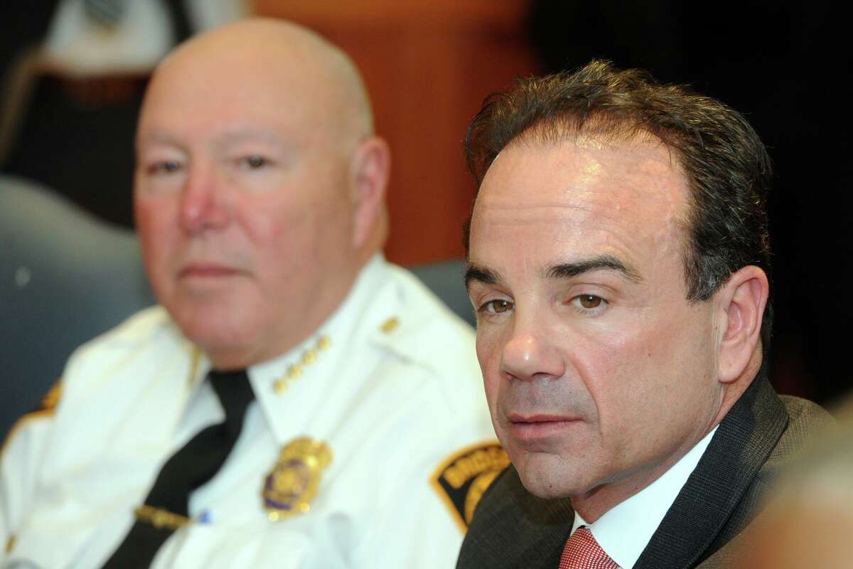"""Mayor Joe Ganim, right, and then-Police Chief Armando """"A.J."""" Perez attend the monthly Communities Working for a Better and United Bridgeport meeting at the Morton Government Center in Bridgeport, Conn. Dec. 18, 2017."""