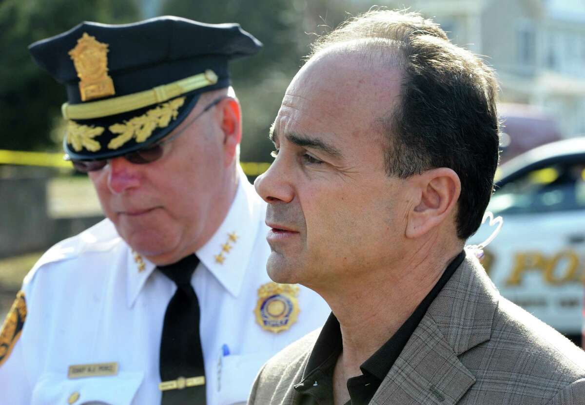 Then-Police Chief Armando Perez, left, and Mayor Joe Ganim address the press at the scene of a homicide at a home on Greenwood Road in Bridgeport, Conn. on Friday, Feb. 24, 2017.