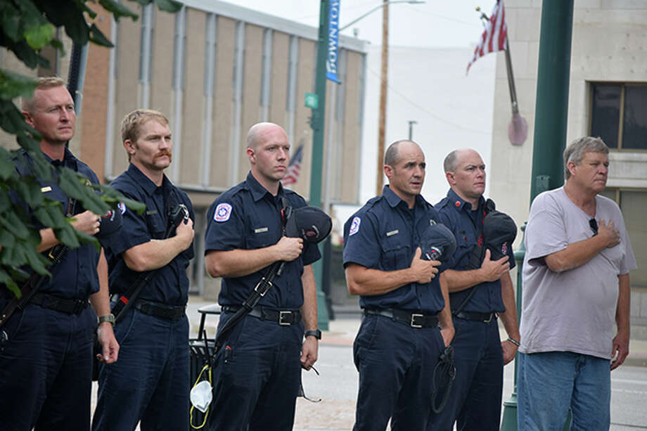 Some of those gathered on the square in downtown Jacksonville show their reverence during a ceremony Friday to recall the terror attacks of Sept. 11, 2001. Photo: Samantha McDaniel-Ogletree | Journal-Courier