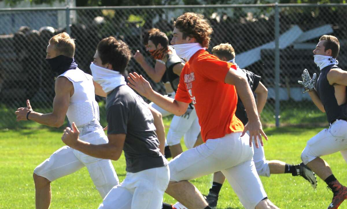 The Harbor Beach Pirates varsity football team practiced under sunny skies on Friday afternoon as they prepared for Week 1 of the MHSAA football season, which kicks off Sept. 18.