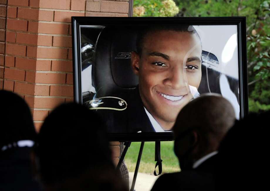 HFM*A photograph of Army veteran Damian Daniels is displayed before mourners during his funeral at Alabama National Cemetery in Montevallo, Ala., on Friday, Sept. 11, 2020. Daniels, an Alabama native who served in Afghanistan, was fatally shot by a sheriff's deputy at his home in San Antonio, Texas, last month. Relatives say he was troubled mentally. (AP Photo/Jay Reeves) Photo: Jay Reeves, STF / Associated Press / Copyright 2020 The Associated Press. All rights reserved.