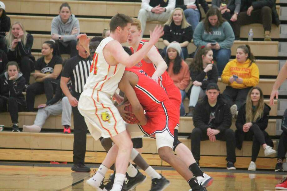 Ferris' Cole Walker (left) focuses on his defense during the 2019-20 men's basketball season. (Pioneer file photo)