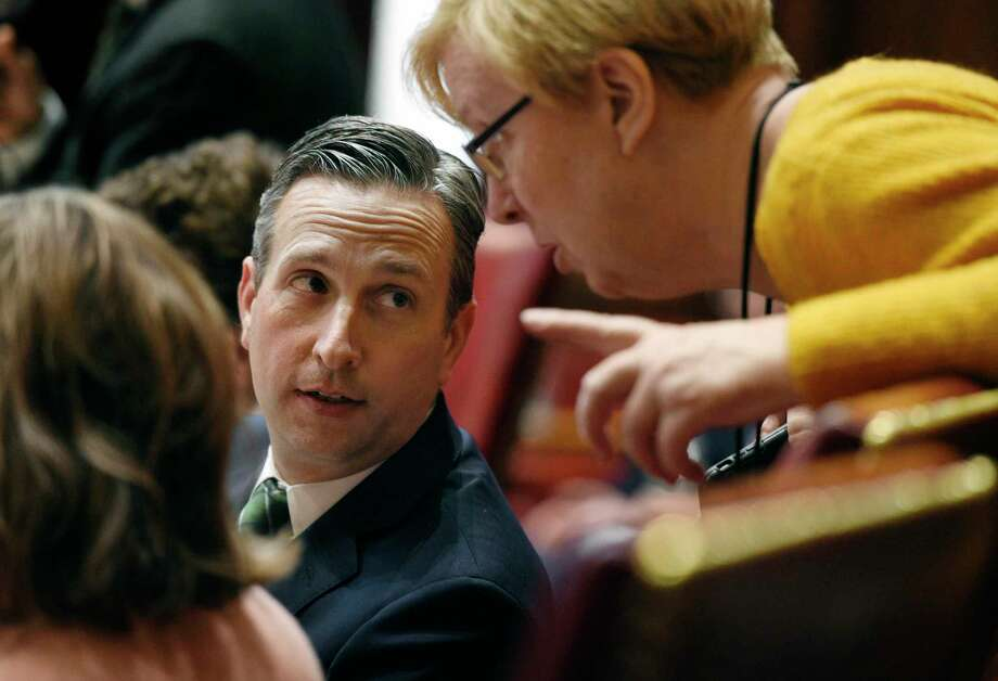 FILE- In this Dec. 18, 2019, file photo, Connecticut Senate Majority Leader Bob Duff, D-Norwalk, left, talks with state Sen. Cathy Osten, D-Sprague, during a special session at the State Capitol in Hartford, Conn. Connecticut State Capitol Police say they have been sending patrols to Duff's Norwalk, Conn., home in response to Duff's claims that Norwalk police officers tried to intimidate him. Capitol police said Thursday, Sept. 3, 2020, that the patrols are just a precaution.(AP Photo/Jessica Hill File) Photo: Jessica Hill / Associated Press / Copyright 2019 The Associated Press. All rights reserved.