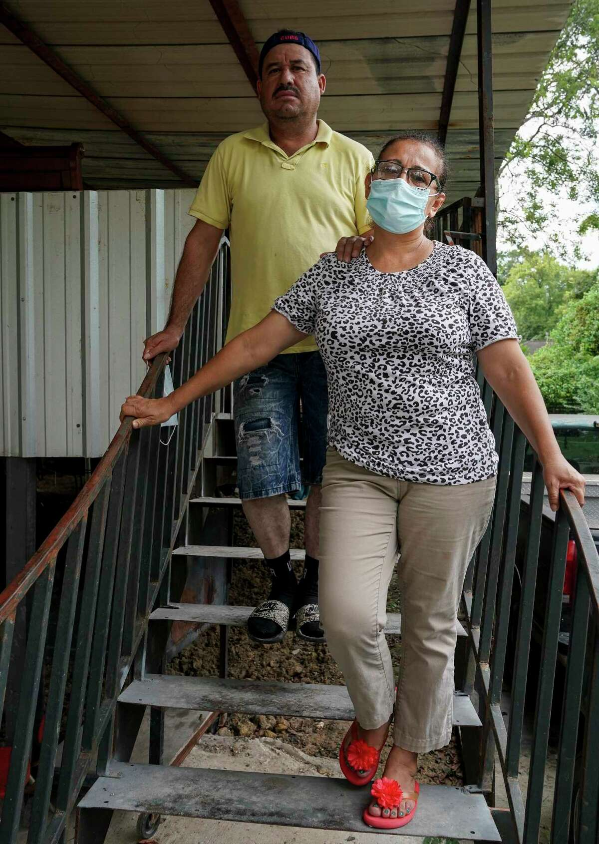 Jose Diaz and his wife Gloria pose for a photograph at their home Friday, Sept. 11, 2020, in Houston. Harris County's mandatory home buyout program, would force the Diaz family to move.